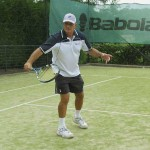 Tennis coach Terry Rocavert using the Ball Machine